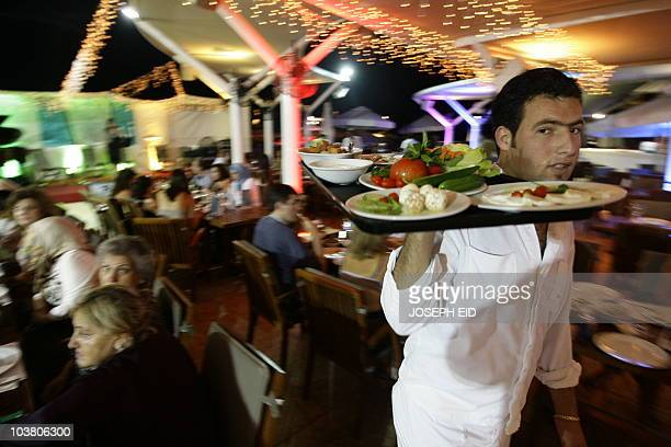 STORY 'LebanonsocialreligionRamadan' FEATURE by Mohamad Ali Harissi A picture taken on August 17 2010 shows a waiter serving the 'suhur' meal just...