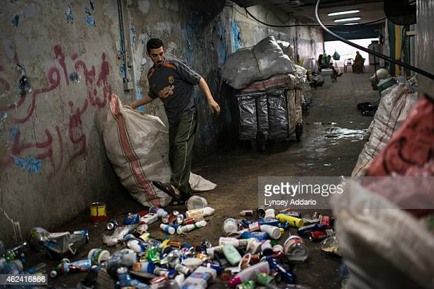 Lebanon/Syrian refugees/Beirut A Syrian refugee family who fled Homs in January 2013 lives in a garage underground where they collect sort and sell...