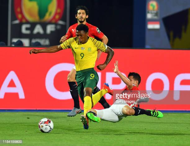 Lebo Mothiba of South Africa challenged by Tarek Hamed of Egypt during the African Cup of Nations Last 16 match between Egypt and South Africa at...