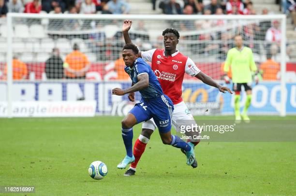 Lebo Mothiba of Strasbourg, Axel Disasi of Reims during the French Ligue 1 match between Stade de Reims and RC Strasbourg at Stade Auguste Delaune on...
