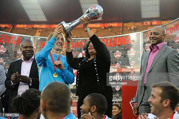 Lebogang Maile Luka Modric of Tottenham Premier of Gauteng province Nomvula Mokonyane and Romeo Kumalo during the 2011 Vodacom Challenge final match...