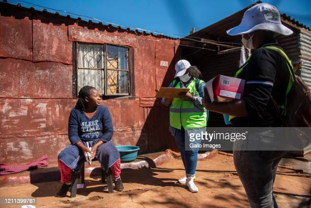 Lebohang Mamitsila and Thabang Magagula some of the City of Tshwane Health workers go door to door to screen for COVID-19 in Attridgeville Township...