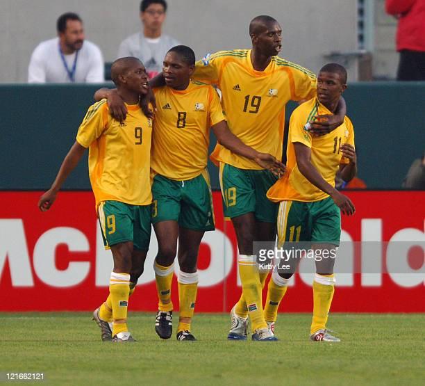 Lebohang Mokoena , Siyabonga Nomvete , Lungisani Ndlela and Elrio Van Heerden of South Africa celebrate during 2-1 victory over Mexico in CONCACAF...