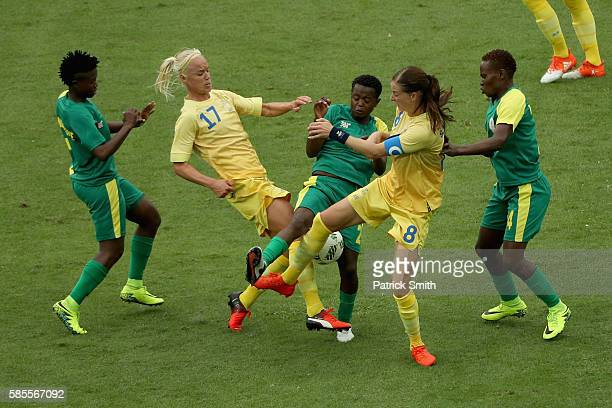 Lebohang Ramalepe of South Africa battles with Caroline Seger and Lotta Schelin during the Women's Group E first round match between Sweden and South...