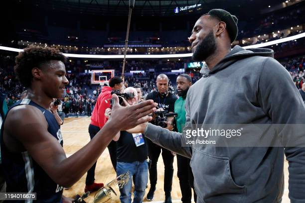 LeBron 'Bronny' James Jr #0 of Sierra Canyon High School is greeted by his father LeBron James of the Los Angeles Lakers following the Ohio...