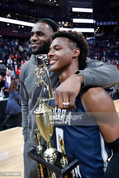 LeBron 'Bronny' James Jr #0 of Sierra Canyon High School with his father LeBron James of the Los Angeles Lakers following the Ohio Scholastic...