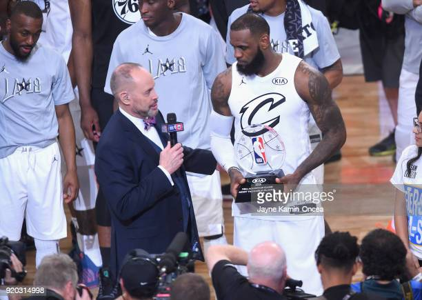 LeBron James accepts the MVP award from TNT sportscaster Ernie Johnson Jr during the NBA AllStar Game 2018 at Staples Center on February 18 2018 in...