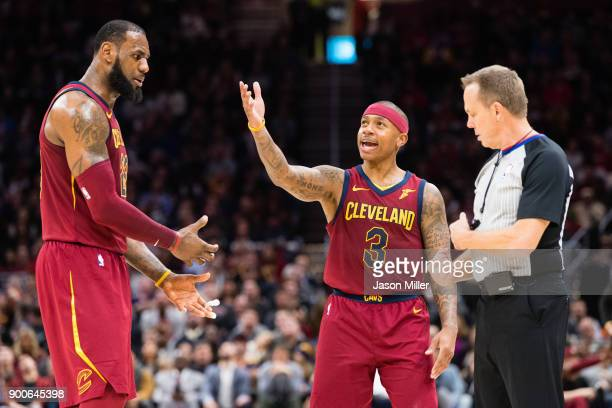 LeBron James an Isaiah Thomas of the Cleveland Cavaliers argue a call with referee Bill Spooner during the second half against the Portland Trail...