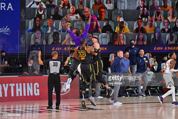 LeBron James and Alex Caruso of the Los Angeles Lakers reacts to a play during the game against the Denver Nuggets in Game two of the Western...