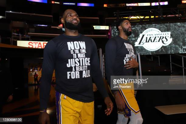 LeBron James and Anthony Davis of the Los Angeles Lakers heads to the court against the Golden State Warriors on January 18, 2021 at STAPLES Center...