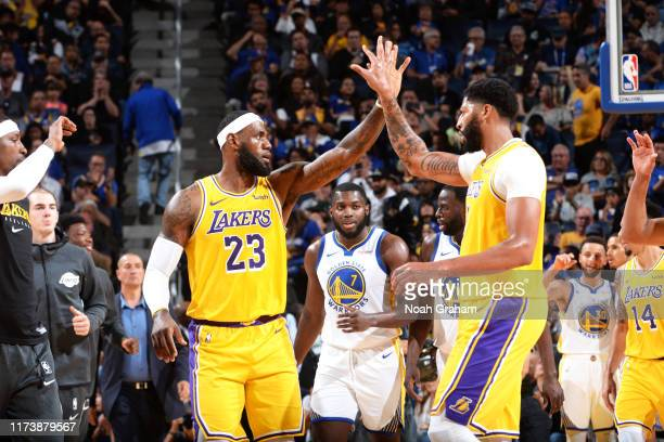 LeBron James and Anthony Davis of the Los Angeles Lakers highfive during a preseason game against the Golden State Warriors on October 5 2019 at...