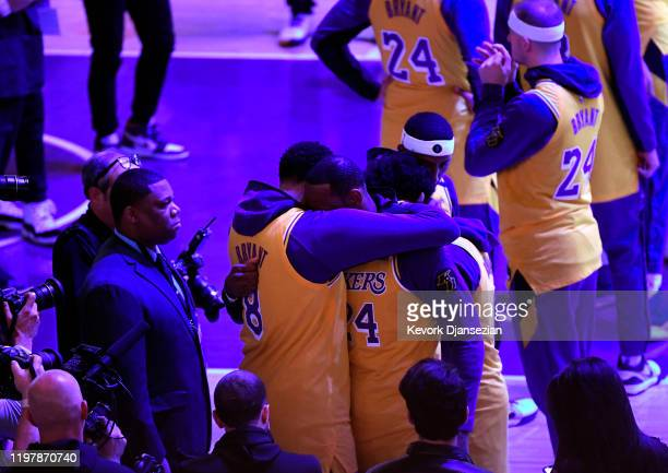 LeBron James and Anthony Davis of the Los Angeles Lakers hug during Los Angeles Lakers pregame ceremony to honor Kobe Bryant before the game against...