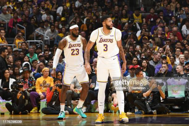 LeBron James and Anthony Davis of the Los Angeles Lakers look on during a preseason game against the Golden State Warriors on October 16 2019 at...