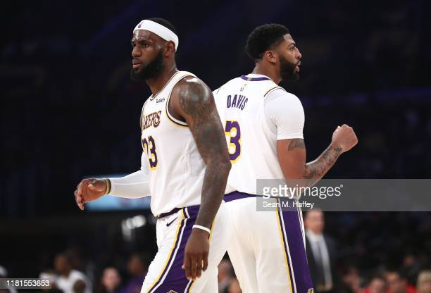 LeBron James and Anthony Davis of the Los Angeles Lakers look on during the second half of a game against the Golden State Warriors at Staples Center...