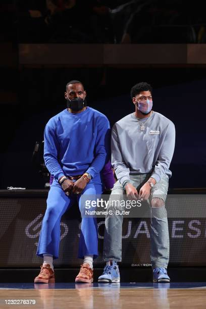 LeBron James and Anthony Davis of the Los Angeles Lakers look on during the game against the New York Knicks on April 12, 2021 at Madison Square...