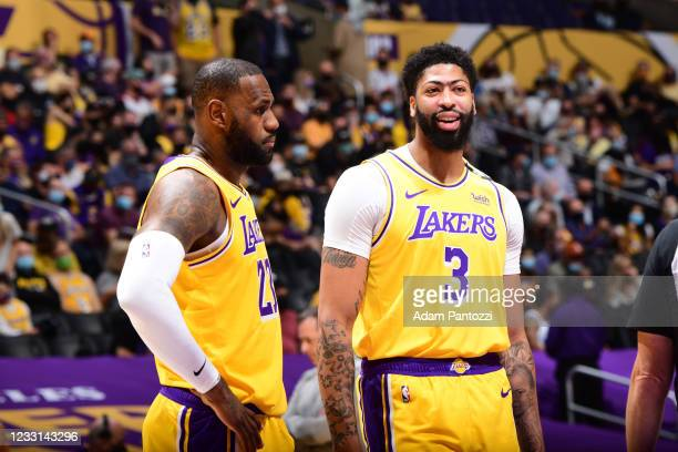 LeBron James and Anthony Davis of the Los Angeles Lakers look on before the game against the Phoenix Suns during Round 1, Game 3 of the 2021 NBA...