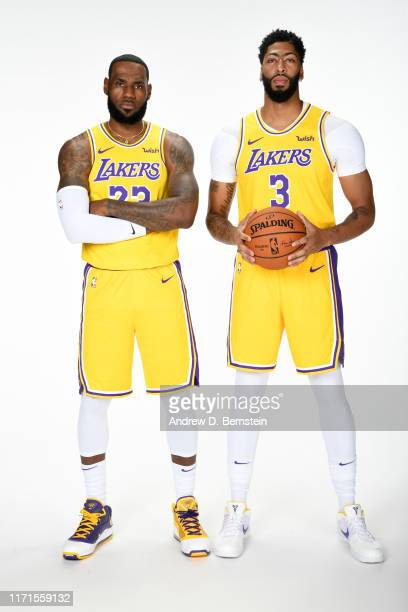 LeBron James and Anthony Davis of the Los Angeles Lakers pose for a portrait during media day on September 27 2019 at the UCLA Health Training Center...
