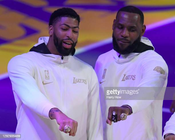 LeBron James and Anthony Davis of the Los Angeles Lakers pose with their rings during the 2020 NBA championship ring ceremony before their opening...