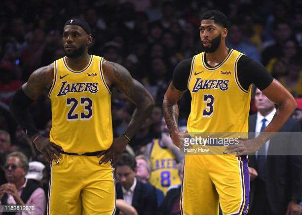 LeBron James and Anthony Davis of the Los Angeles Lakers react as they trail the LA Clippers during the fourth quarter in a 112102 Clippers win...
