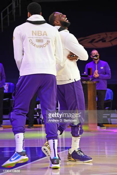LeBron James and Anthony Davis of the Los Angeles Lakers react as they get their 2019-20 NBA Championship ring during the ring ceremony before the...