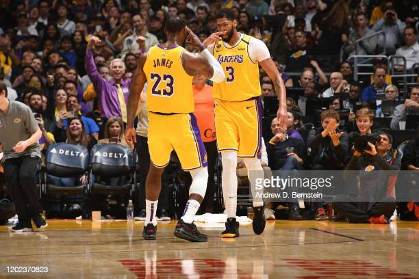 LeBron James, and Anthony Davis of the Los Angeles Lakers react to a play against the Memphis Grizzlies on February 21, 2020 at STAPLES Center in Los...