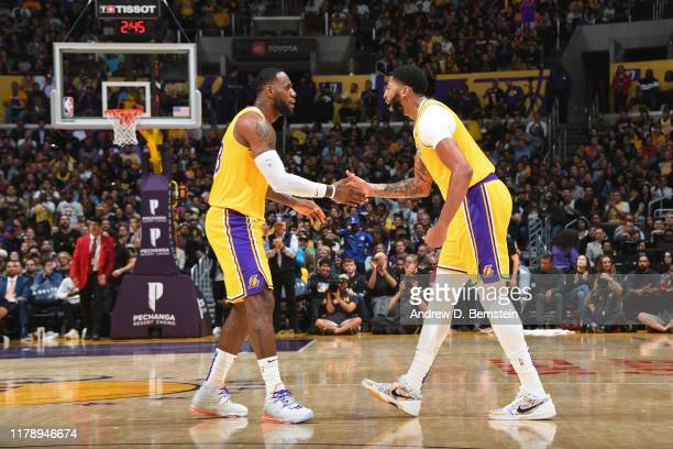 LeBron James and Anthony Davis of the Los Angeles Lakers shake hands against the Memphis Grizzlies on October 29 2019 at STAPLES Center in Los...