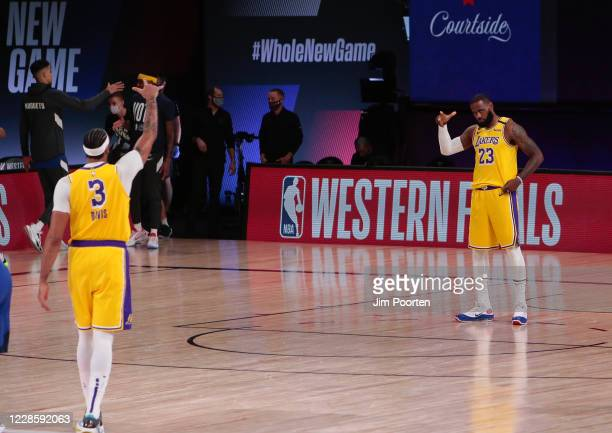LeBron James and Anthony Davis of the Los Angeles Lakers signals during the game against the Denver Nuggets in Game one of the Western Conference...