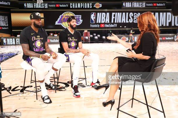 LeBron James and Anthony Davis of the Los Angeles Lakers talks with reporter Rachel Nichols after winning Game Six of the NBA Finals on October 11,...