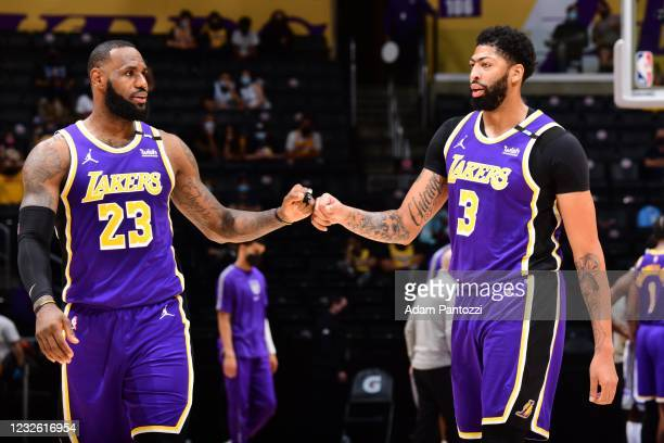 LeBron James and Anthony Davis of the Los Angeles Lakers touch knuckles during the game against the Sacramento Kings on April 30, 2021 at STAPLES...