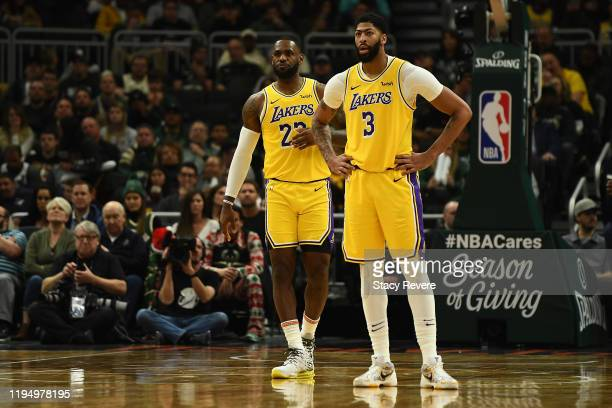 LeBron James and Anthony Davis of the Los Angeles Lakers wait for a free throw during the second half of a game against the Milwaukee Bucks at Fiserv...