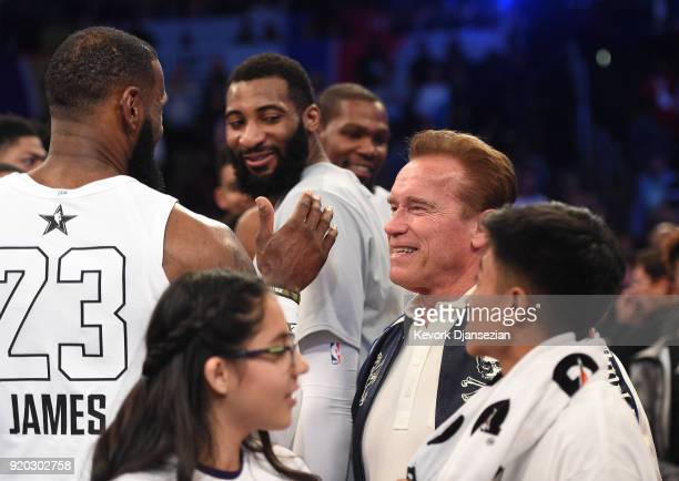 LeBron James and Arnold Schwarzenegger high five during the NBA AllStar Game 2018 at Staples Center on February 18 2018 in Los Angeles California