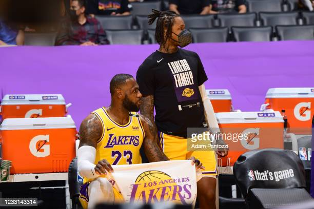LeBron James and Ben McLemore of the Los Angeles Lakers look on during the game against the Phoenix Suns during Round 1, Game 3 of the 2021 NBA...