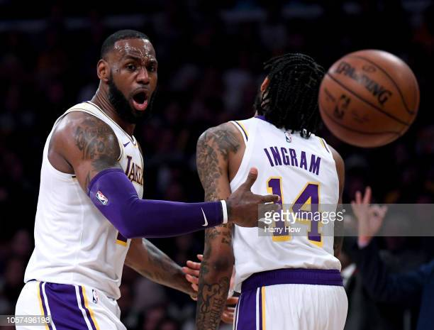 LeBron James and Brandon Ingram of the Los Angeles Lakers react to a Laker foul during the first half against the Toronto Raptors at Staples Center...