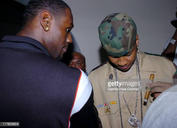 Lebron James and Carmelo Anthony during Hakim Warrick and Raymond Felton's Draft Party at Glo June 28 2005 at Glo in New York City New York United...