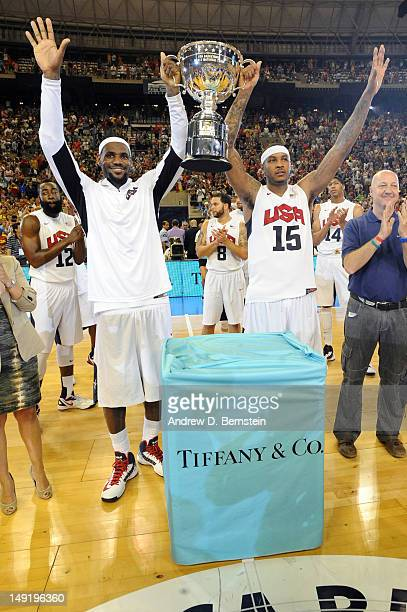 LeBron James and Carmelo Anthony of the US Men's Senior National Team hold up the trophy as the game MVPs after a game against the Spanish Men's...