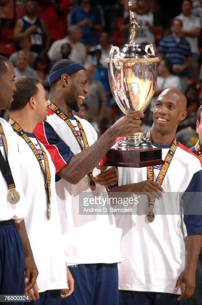 LeBron James and Chauncey Billups of the USA Men's Senior National Team smile while holding the first place competition trophy during the medal...