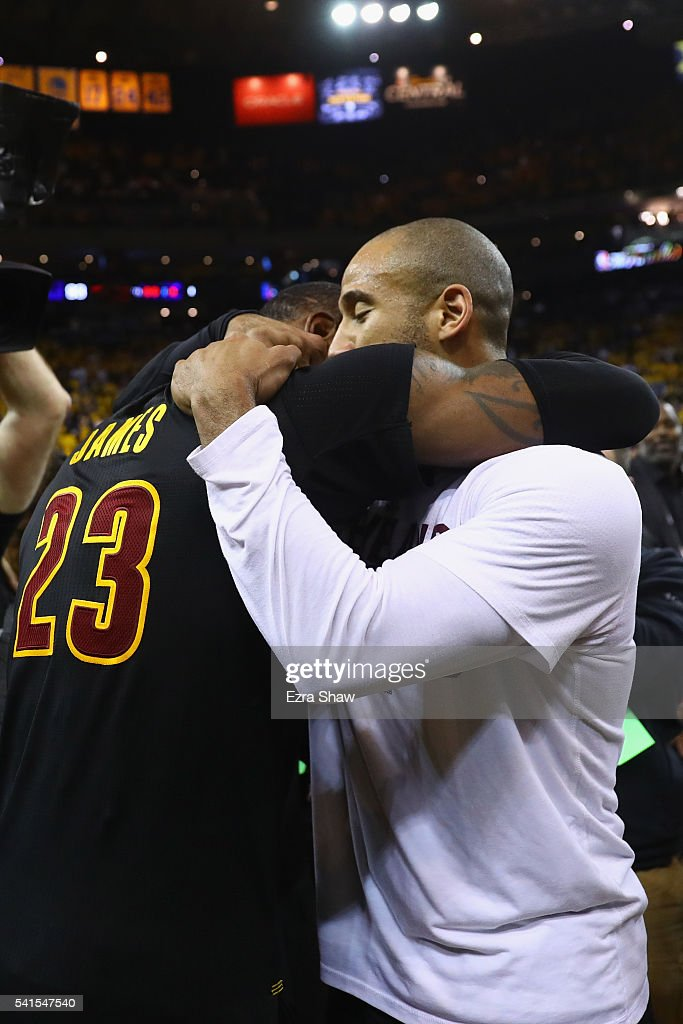 LeBron James #23 and Dahntay Jones #30 of the Cleveland Cavaliers celebrate after defeating the Golden State Warriors 93-89 in Game 7 of the 2016 NBA Finals at ORACLE Arena on June 19, 2016 in Oakland, California.
