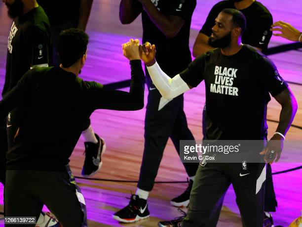LeBron James and Danny Green of the Los Angeles Lakers lock pinkie fingers during player introductions against the Sacramento Kings at The Field...
