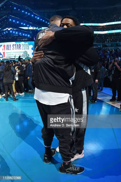 LeBron James and Dwyane Wade of Team LeBron hug before the 2019 NBA AllStar Game on February 17 2019 at the Spectrum Center in Charlotte North...