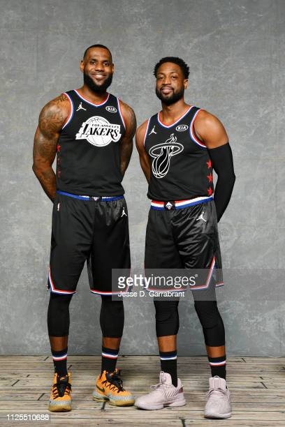 LeBron James and Dwyane Wade of Team LeBron pose for a portrait prior to the 2019 NBA All Star Game on February 17 2019 at Spectrum Center in...
