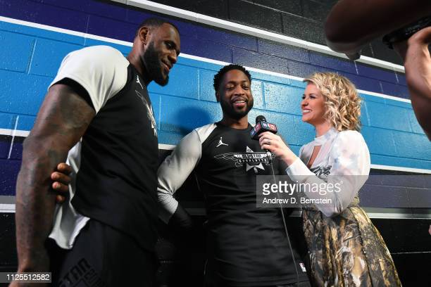 LeBron James and Dwyane Wade of Team LeBron speak to Kristen Ledlow before the 2019 NBA AllStar Game on February 17 2019 at the Spectrum Center in...
