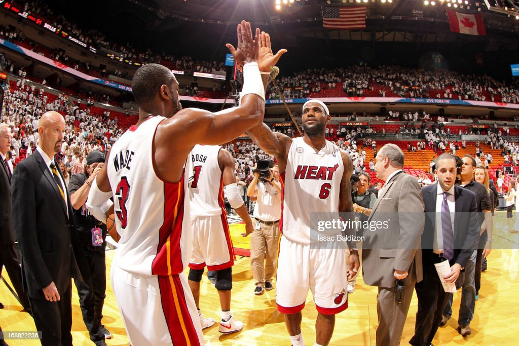 LeBron James #6 and Dwyane Wade #3 of the Miami Heat celebrate following their team's series victory against the Chicago Bulls in Game Five of the Eastern Conference Semifinals during the 2013 NBA Playoffs on May 15, 2013 at American Airlines Arena in Miami, Florida.