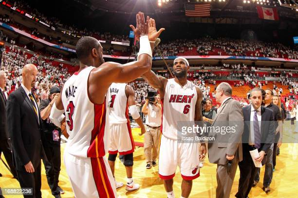LeBron James and Dwyane Wade of the Miami Heat celebrate following their team's series victory against the Chicago Bulls in Game Five of the Eastern...