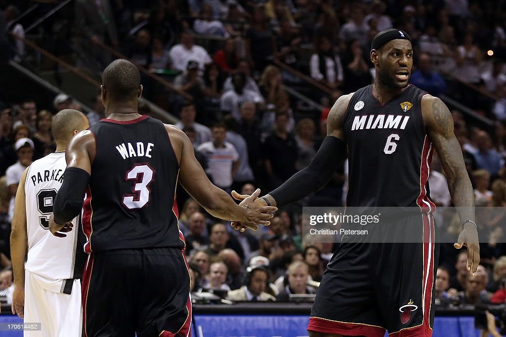 LeBron James #6 and Dwyane Wade #3 of the Miami Heat celebrate in the fourth quarter while taking on the San Antonio Spurs during Game Four of the 2013 NBA Finals at the AT&T Center on June 13, 2013 in San Antonio, Texas.