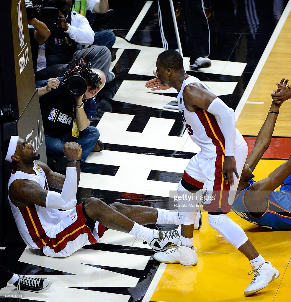 LeBron James #6 (L) and Dwyane Wade #3 of the Miami Heat reacts after James made a basket over Kevin Durant #35 of the Oklahoma City Thunder in the fourth quarter of Game Three of the 2012 NBA Finals on June 17, 2012 at American Airlines Arena in Miami, Florida.