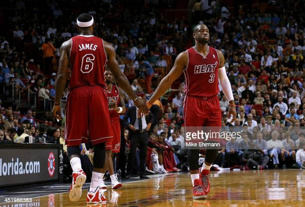 LeBron James and Dwyane Wade of the Miami Heat shake hands during a game at American Airlines Arena on November 25 2013 in Miami Florida NOTE TO USER...