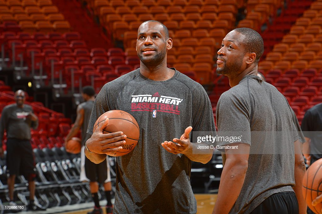 LeBron James and Dwyane Wade of the Miami Heat warm up at practice as part of the 2013 NBA Finals on June 19, 2013 at American Airlines Arena in Miami, Florida.