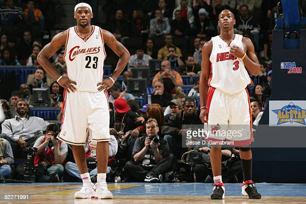 LeBron James and Dwyane Wade of the Sophomore Team look on against the Rookie Team in the got milk Rookie Challenge during 2005 NBA AllStar Weekend...
