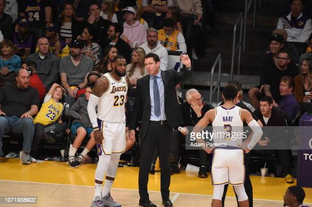 LeBron James and Head Coach Luke Walton of the Los Angeles Lakers are seen talking during the game against the Phoenix Suns on December 2 2018 at...