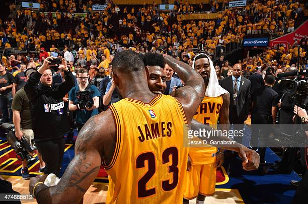 LeBron James and Iman Shumpert of the Cleveland Cavaliers shares a moment after the game against the Atlanta Hawks at the Quicken Loans Arena During...